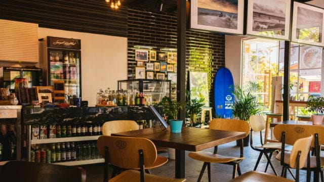 Grow your restaurant's revenue - dining room and bar with sunlight coming in through the windows.